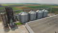Aerial view of agriculture grain silos storage tank. FullHD 48800159