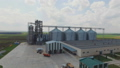Aerial view of agriculture grain silos storage tank. FullHD 48800160