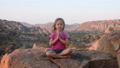 Little cute girl meditating on top of mountain. 48804601