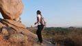 Young woman tourist with backpack walking at trail In mountains 48804607