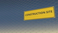 CONSTRUCTION SITE sign an a mesh wire fence against blue sky. 3D animation 48814285