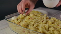 Close-Up, Woman's Hand Lays Cheese Balls onto Pasta 48847243