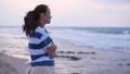 Woman looking at sea waves 48879894