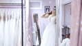 girl tries on a dress in the wedding shop 48893270