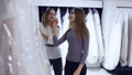 two girls look of wedding dresses in bridal salon 48893273