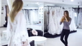 girl tries on a dress in the wedding shop 48893274