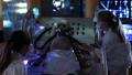 Children doing an humanoid alien operation 48893278