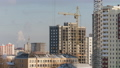 Tower cranes working on construction site residential estate building, building constructors working 48895340