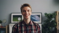 Portrait of happy good-looking guy in trendy checkered shirt smiling and looking at camera standing 48926565