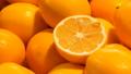 Beautiful ripe oranges at market stall. Orange fruits background 48931381