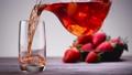 Glass of red lemonade or juice 48933288