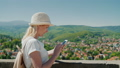 Always connected. A woman tourist with a smartphone in the background of a beautiful town in Germany 48933703