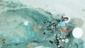 Colorful paint in bubbles organically moves in the liquid 48947699