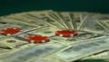 Casino chips falling on dollar bills, big  48954761