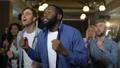Multi-racial friends applauding watching game  48954779