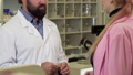 Unrecognizable pharmacist giving shopping bag with medicine to a customer 48985362
