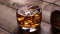 Whiskey in the glass with nice reflection. With ice cubes. 49057028