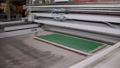 industrial automated equipment is shaping base for ceramic tile, moving details, dry clay 49076348
