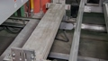 automatic machine is moving and preparing for packaging finished ceramic tile 49076817