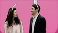 Young couple are beautiful on pink background. During this time, they are dressed in rabble ears 49076918