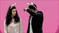 Young couple are beautiful on pink background. During this time, they are dressed in rabble ears 49076929