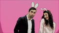 Young beautiful couple standing on a pink background. During this, they are dressed in rabble ears 49077043