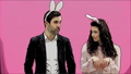 Young couple standing standing on pink background. During this time, they are dressed in rabble ears 49077621