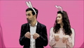 Young couple standing standing on pink background. During this time, they are dressed in rabble ears 49077623
