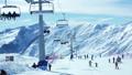 People skiing mountains 49090183