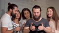 Bearded man using virtual reality glasses with his friends 49109621