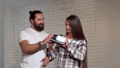 Handsome bearded man watching his girlfriend using virtual reality glasses 49109623