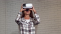 Attractive young woman looking excited, using virtual reality glasses 49109624