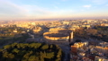 Flying over Colosseum, Rome, Italy. Aerial view of the Roman Coliseum on sunrise 49110716