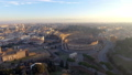 Flying over Colosseum, Rome, Italy. Aerial view of the Roman Coliseum on sunrise 49110717