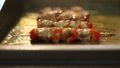 Appetizing kebabs on a heated showcase in a cafe 49137031