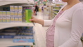 Young pregnant woman choosing baby nutrition in supermarket store 49138805
