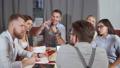 Group of co-workers is meeting in office, chatting cheerfully 49142824