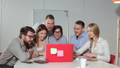 Group of young officer workers are viewing funny video at laptop, smiling faces 49144023