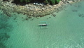 Aerial drone view of traditional philippines boats anchored in the bay with clear and turquoise 49166118