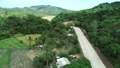 Aerial view of countryside road passing through the lush greenery and foliage tropical rain forest 49166119