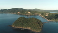 Aerial drone flight over island covered with tropical forest on sunset time. Tropical paradise bay 49169487