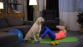Loving woman owner kissing dog doing abs exercises 49228301