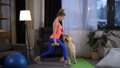 Fit woman with dog doing lunge excercise at home 49228321