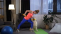 Sporty fit woman with dog assistant training arms 49228330