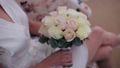 Young girl holding a bouquet of the bride. Close-up. Wedding bouquet. Beautiful bridal bouquet in 49261117