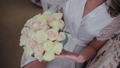 Young girl holding a bouquet of the bride. Close-up. Wedding bouquet. Beautiful bridal bouquet in 49261132