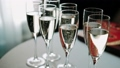 Waiter pours champagne in glasses on wedding. Close up 49261156