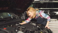 Engines trend monitoring. Cute blonde learning to fix the car 49267403