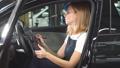 Smiling girl monitoring a car 49273508