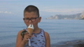 Child on the beach eats ice cream from a waffle cone 49290942